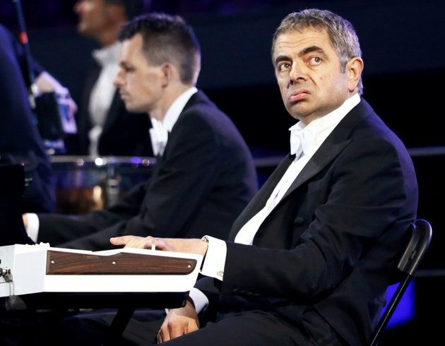 London 2012 Opening Ceremony - Actor Rowan Atkinson, known for his role as Mr Bean, performs during the opening ceremony of the London 2012 Olympic Games at the Olympic Stadium July 27, 2012. REUTERS/Kai Pfaffenbach