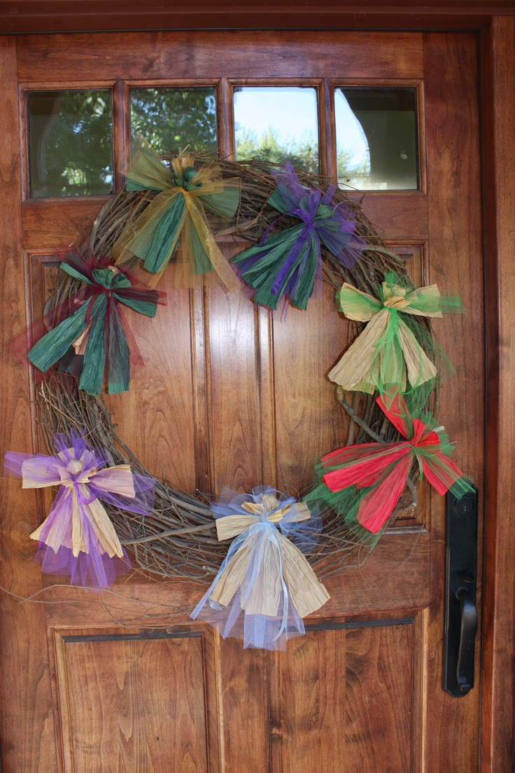 Raffia angels I'm making for donation to the animal shelter.  I put these on the wreath just for display purposes.  You could really bling these up with all kinds of goodies!