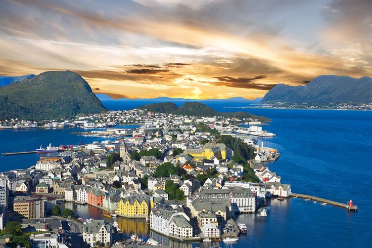 Alesund town, Norwegian fjords, Norway Located in the western coast of Fjord Norway is Alesund town. The beauty of this place is that it is surrounded...