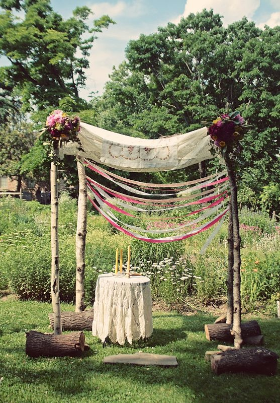 A chuppa- a simple, pretty and organic way to keep the sun off your faces during the ceremony. Easy DIY, with some bamboo from Home Depot, Burlap or pretty fabric, ribbons and flowers!