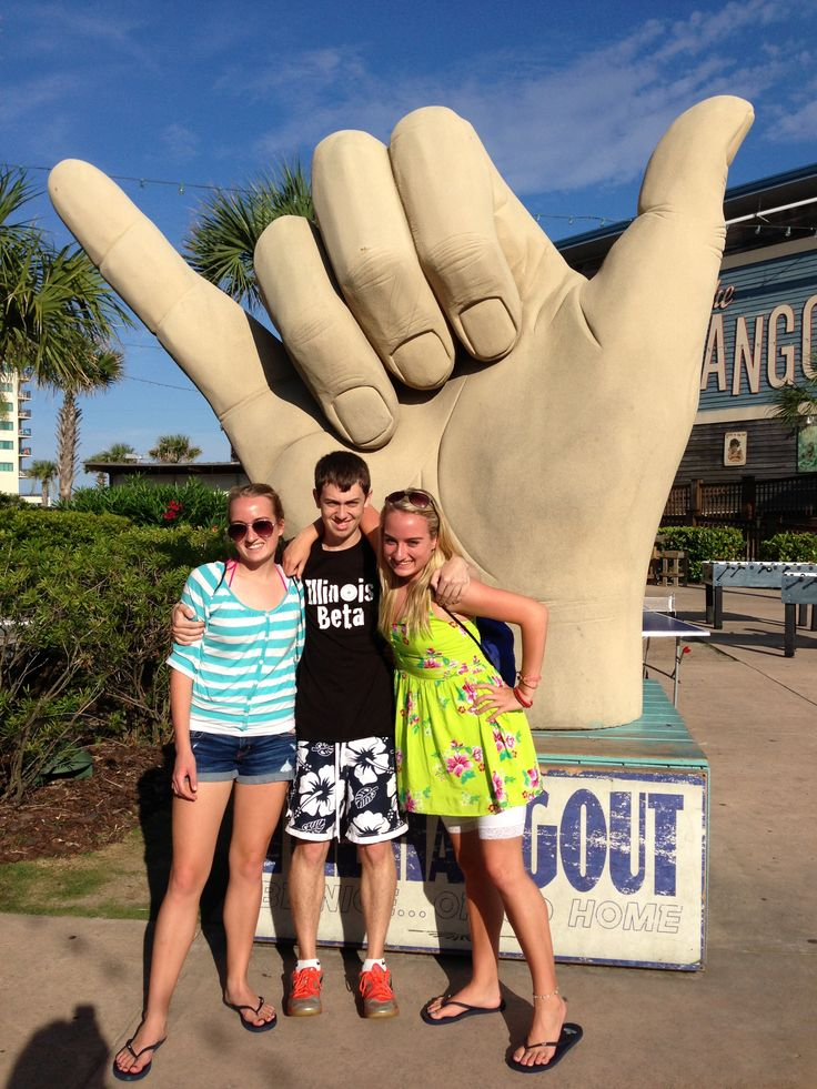 Hannah Holmes, Wyatt Whewell, and Heather Holmes, all of Lawrenceville, IL, take a break from The National Beta Convention in Mobile, AL to hang out at The Hangout in Gulf Shores, AL on June 22, 2013.