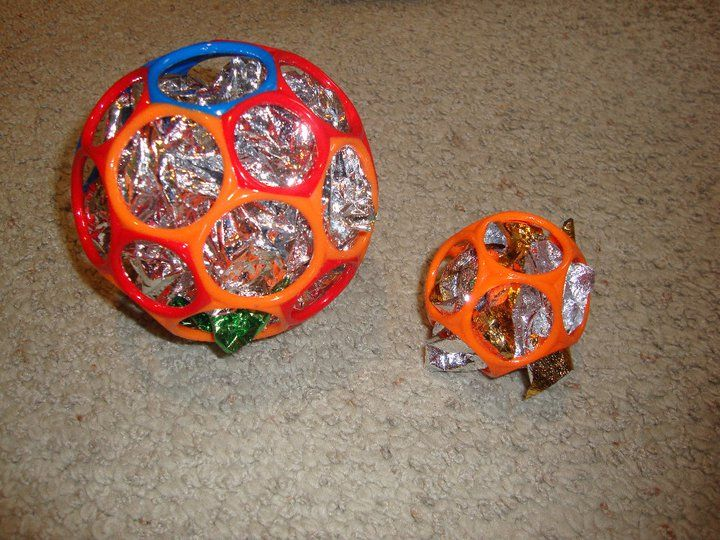 Gripper O-Ball filled with shiny mylar- old mylar balloons or emergency blankets…