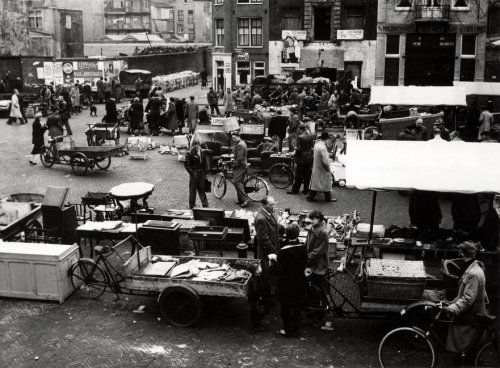 1955. Flea market at the Waterlooplein in Amsterdam. The Waterlooplein is a square in the center of Amsterdam, near the river Amstel. It was created in 1882 when the Leprozengracht and Houtgracht canals were filled in. In 1893 the square became a daily marketplace when the city government decided that the Jewish merchants in the nearby Jodenbreestraat and Sint Antoniebreestraat had to move their stalls to the Waterlooplein. Photo Spaarnestad / Henk Blansjaar. #amsterdam #1955 #waterlooplein