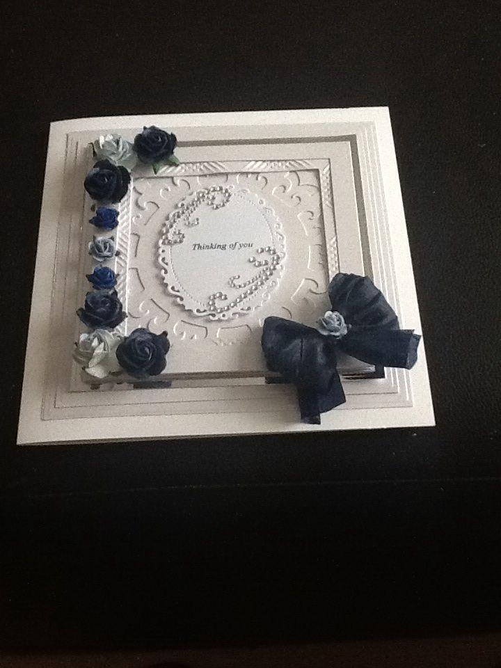 An 8 x 8 card base decorated with the Grand Squares and Ive added a tonic die in the centre. The flowers are from Wild Orchid