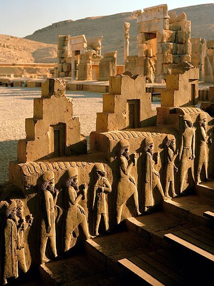 Envoys bearing tribute march eternally up a ceremonial staircase in the spectacular ruins of Persepolis, capital of the once mighty Achaemenian Empire, which during the time of Xerxes (486-465 B.C.) had dominated the civilized world.