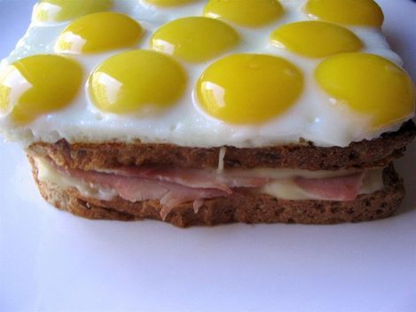 Crazy croque-madame topped with quail eggs.