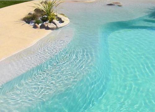 Pool that looks like a beach in your back yard :)Yes please!