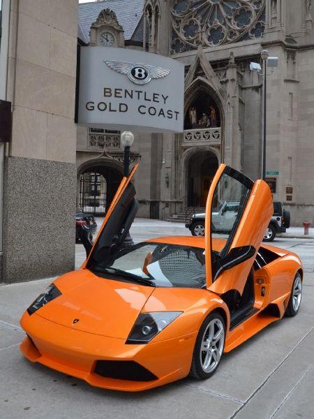 2009 Lamborghini Murcielago.  Why is it under a bentley dealership sign? It's a Lamborghini, not a Bentley.