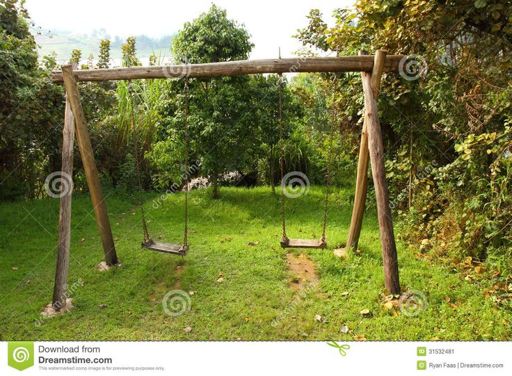 pictures of wooden swing set | rustic wooden swing set sitting in a clearing in the forest.