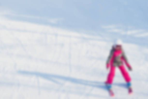 blur image of teenage girl learning on equipped for skiing snowy at