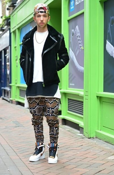 TRIBAL WARRIOR: We love to see a man who can experiment with print and colour, with Aztec vibes, and this wicked snake print drop crotch pants infused with elements of the rainforest. #carnabystreet #menwithstyle #tribal