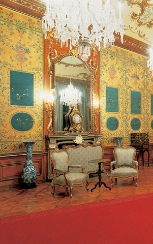 Schonbrunn Palace and Park - Blue Chinese Salon, furnished with painted Chinese rice-paper wall coverings incorporating rectangular and oval pictures containing scenes representing the production of silk, porcelain, tea and rice