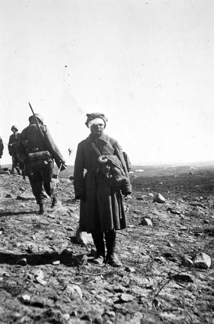 The same Soviet soldier now bandaged up by his captors. Titovka River, Murmansk Oblast, USSR. 29th June, 1941