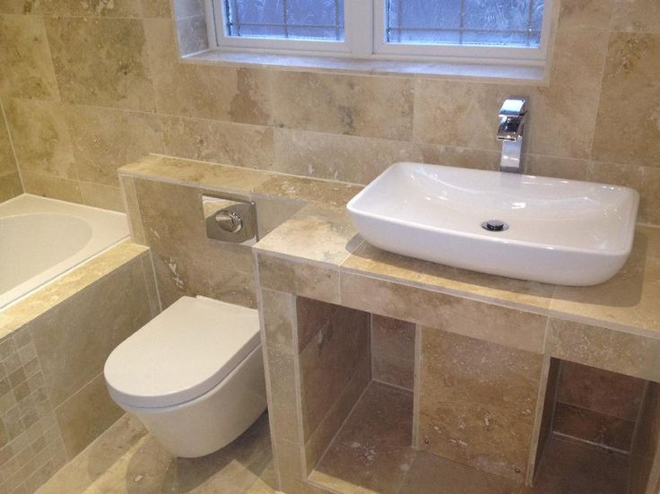 Jennifer from Dunfermline tiled over all of the surfaces in her bathroom to create a spa like design. the white counter top basin looks great alongside the wall hung toilet. #VPShareYourStyle