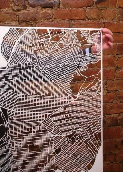 """Karen O'Leary took a blade to these large sheets of paper to create """"Map Cuts"""" of New York and Paris"""