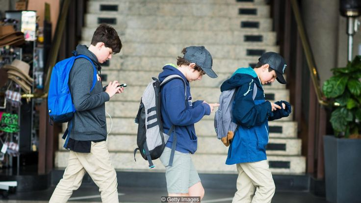 (Credit: Getty Images) Bowed head club- thumb clan- people addicted to their cell phones