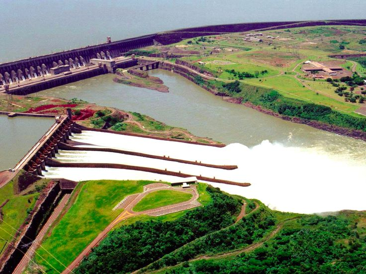 """The world's largest power plant is a $27 billion 'engineering wonder' - Located on the border of Brazil and Paraguay, theItaipú Dam produced 103.09 million megawatt-hours (MWh) of electricity in 2016 — making the hydroelectric system the world's largest power plant.  Ten years after its completion in 1984,the American Society of Civil Engineers named it """"one of the seven engineering wonders of the modern world.""""  Building the $27 billion Itaipú Damrequired 18 years and 40,000 workers…"""