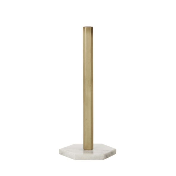 This paper towel stand from luxury Danish brand Ferm Living will decorate and shine in any kitchen. It is made of solid brass with a matte finish and marble foo