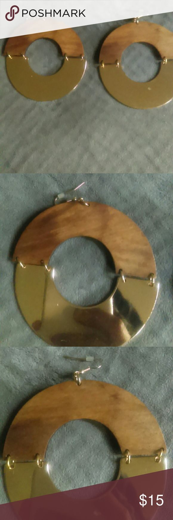 Wooden hoop earrings Gold and wooden hoop earrings brand new never been worn if you have any questions please ask. Aldo Jewelry Earrings