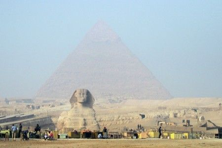 Ag Adibudojo: 2.5 BCE. The Sphinx of Giza is a giant (66 feet (20 meters) high and 240 feet (73 meters) long) statue near the Giza pyramids in Egypt. Crafted in the shape of a lion with a man's head, it is thought to have been built during the rule of Pharaoh Khafre (2520-2494 BCE), or at least sometime in that millenium. Despite it being one of the world's oldest and most famous statues, its origins are still fairly mysterious.   2.0 ACE In front of the statue Spink, souvenir sellers ...