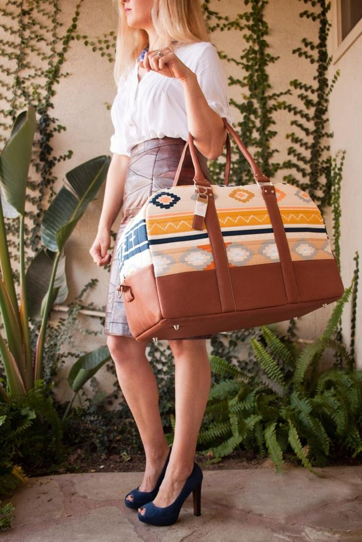 """Love this for a weekend trip bag! Jennifer send her """"GPS Weekender Bag"""" The outer portion of the bag is Bound Canvas with lambskin trim.  The inner portion of the bag is lined with Wanderer fabrics. If you like this bag make sure to give it a HEART/LIKE. Re-PIN for an extra point towards this project."""