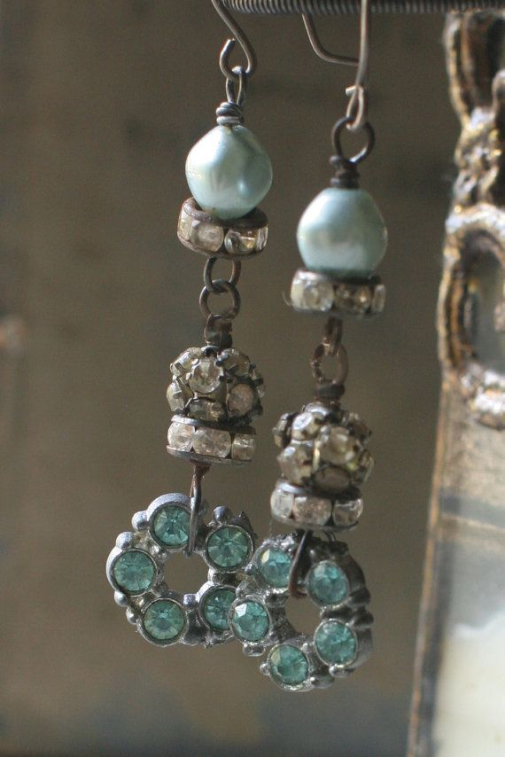 Aqua rhinestone findings dangle below rhinestone balls, rondelles and old blue beads. Hangs about 2 inches below sterling silver ear wires.