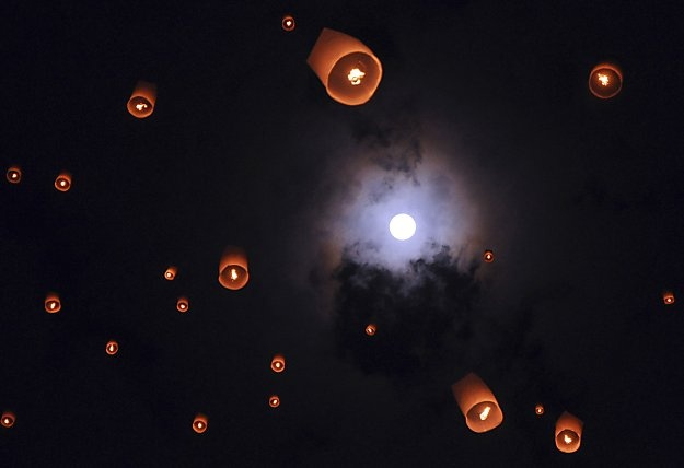 May 7, 2012 //   Lanterns released by Buddhist worshippers ascend under a full moon during Waisak Day at Borobudur temple in Magelang, Java. Waisak Day marks the birth, death and enlightenment of Buddha.