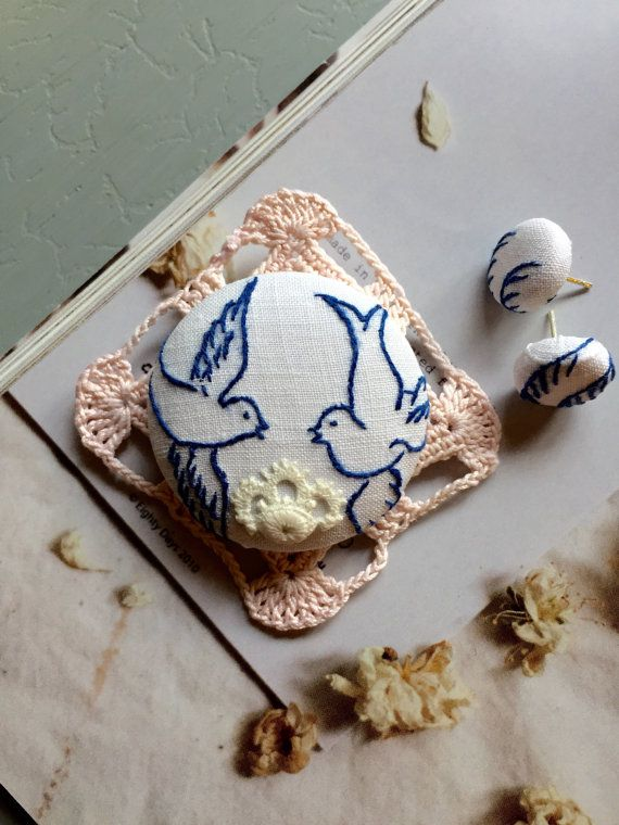 blue and white swallow bird brooch set with by BestowedCollections