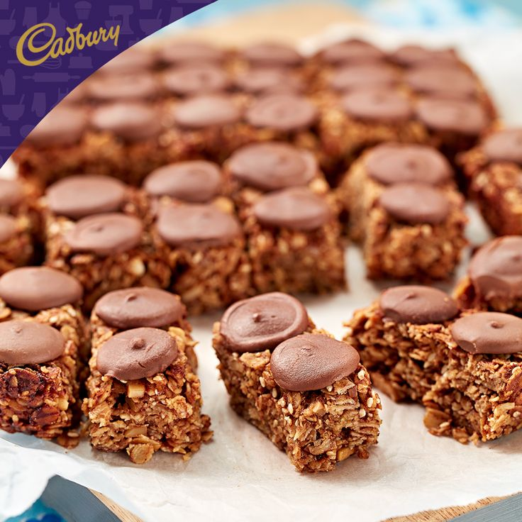 There's a lot to love about these Banana Oat Slices! Bite-size and sharable, the kids will love them, as will all your colleagues. So, pull on your apron and bake up a storm!  #bakeitcadbury #baking #CADBURYrecipes #chocolate #healthyliving