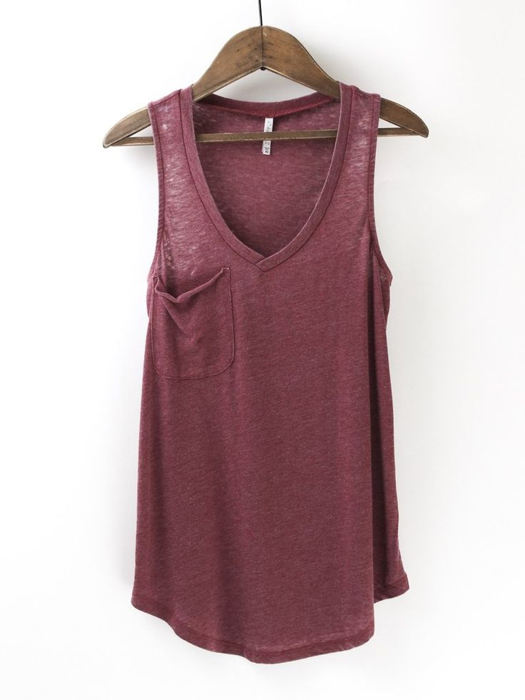 "Another Z Supply classic! ""The"" Pocket Racer, relaxed fitted racer tank top. Made from the Z Supply Signature Burnout jersey fabric, this tank features a slouchy chest pocket, a v-neckline and curved hem. More colors available online at therollinj.com"