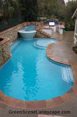 Outdoors kitchen, wading pool area, long bench, my entire checklist in a small pool!