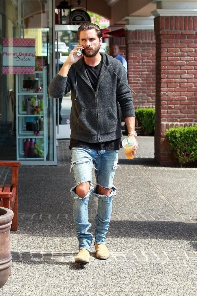 Scott Disick wearing Fear of God Selvedge Denim Vintage Indigo Jeans, John Elliott Mercer T-Shirt and Common Projects Suede Chelsea Boots