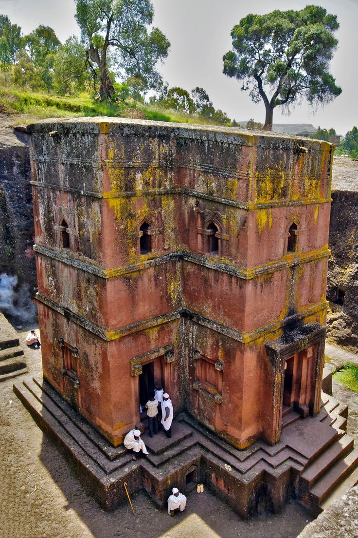 Africa | The Church of St. George is 1 of 11 monolithic churches in Lalibela, a city in the Amhara Region of Ethiopia. Carved from solid red volcanic rock in the 12th century, it is the most well known and last built of the eleven churches in the Lalibela area, and has been referred to as the 8th Wonder of the World. The dimensions of the trench are 25 meters by 25 meters by 30 meters. | ©Lech Magnuszewski