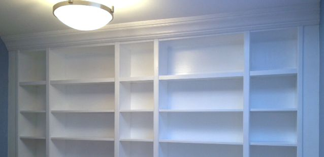 Transforming stock Ikea Billy Bookcases into a built-in bookcase wall. Custom results on a budget!