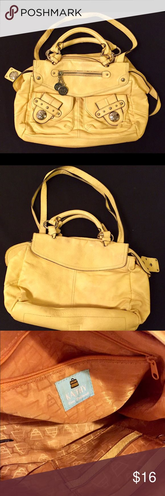 Kathy Van Zeeland yellow 100% Vinyl Purse. Yellow 100% Vinyl with 100% Polyester Lining. Multiple pockets on the outside and inside. Sliver metal buttons on pockets. Some signs of being used but not to noticeable. Kathy Van Zeeland Bags