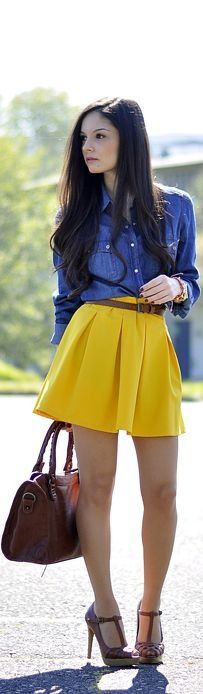 dark wash denim long sleeve shirt tucked in - yellow circle skirt - brown braided single belt - brown handbag - brown heels:
