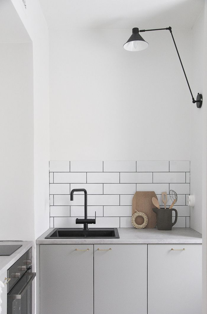 Small greige kitchen, black details. by Minna Jones