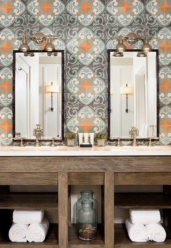 In the baths, millwork, hand-finished mirrors, and Rohl plumbing are framed by custom-designed caustic cement tiles.