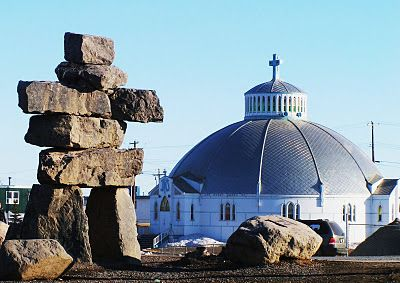 The Igloo Church with a large Inukshuk.