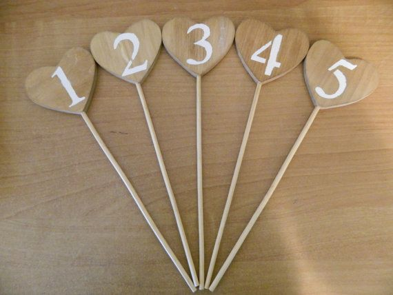 Table numbers to put in flower jars...crescents would be better.
