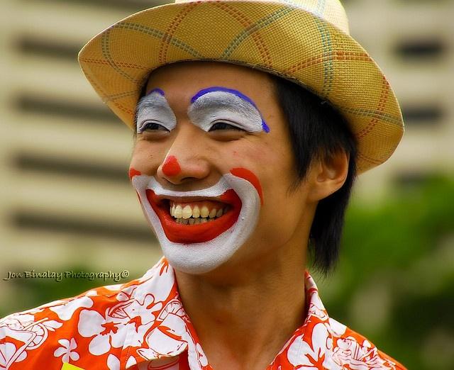Happy Clown wearing a straw hat