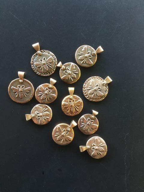Sand-cast bronze BEE pendants.. silver rivet
