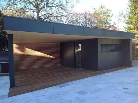 vue de face de la construction d'un abri de jardin en bois design en Alsace