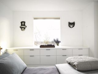 Built in dresser under window would add a cushion to make a window seat on top would be a great use of space.
