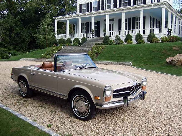 Mercedes Benz 280SL...always wanted one of these, teal convertible, white interior....wish.