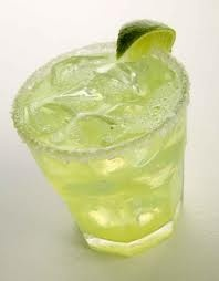 Homemade Margaritas on the rocks.  No mix allowed!  Cuervo Gold, Lime Juice.  Cointreau.  Ice.  Salt.  Perfection.