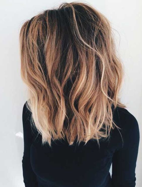 Long bob with long layers-- dark brown roots with caramel and blonde pieces woven in. Beautiful balayage.: