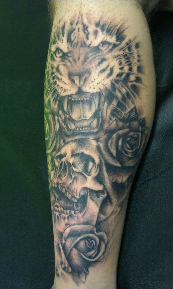 Wrist tattoo with skull, tiger and roses