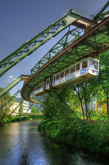 Wuppertal, Germany: is a city in North Rhine-Westphalia, located in the Wupper River valley, east of Düsseldorf and south of the Ruhr area. Two-thirds of the total municipal area is green space. It is known for its steep slopes, parks, and its unique suspension railway, the Wuppertal Schwebebahn. I stopped on my bicycle tour through Europe in 1979. I stayed at the local IYH before pushing my bike up a hill and cycling on and to Cologne.