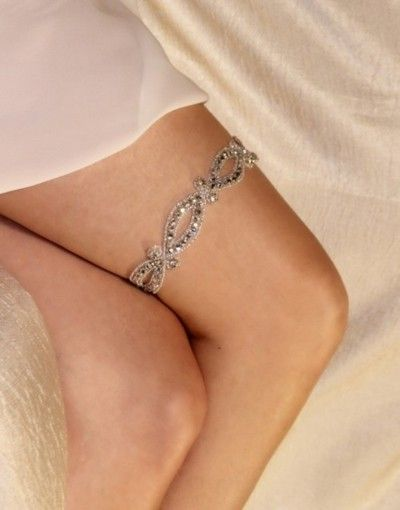 bride2be:    i love the new trend in garters… no more of those ugly scrunched up ones, and now tons of more feminine pretty garters that are really a shame to even think about using for the garter toss during the reception!